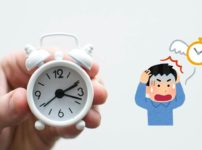 頭を抱えた男性と羽根が生えた時計